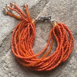 Vintage orange multi strand seed bead bracelet